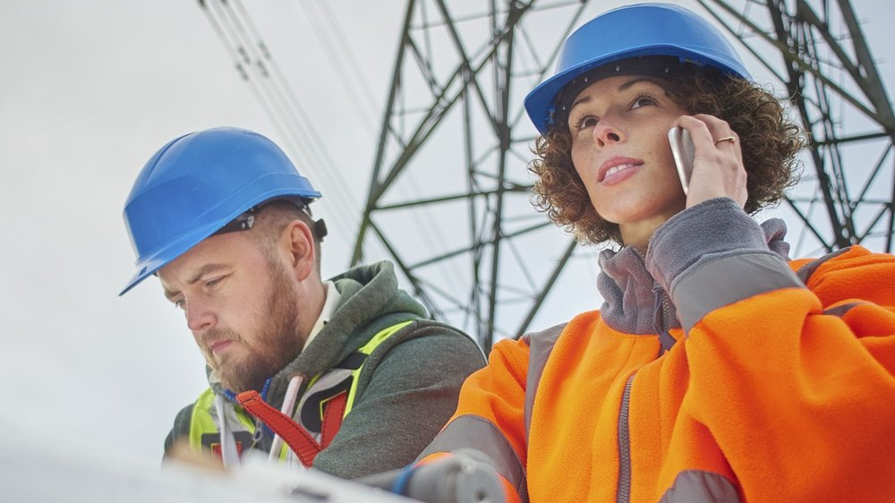 electricity-engineers-beneath-a-pylon-Electricity-Pylon-Working-Industry-Occupation copy - Copy.jpg