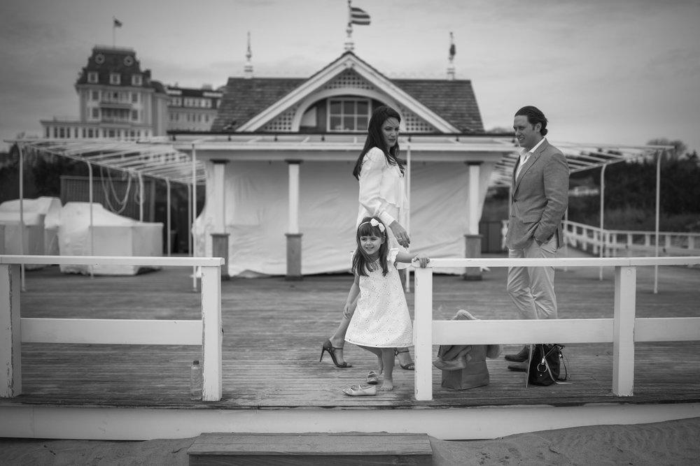 Family on a beach candid style photos.