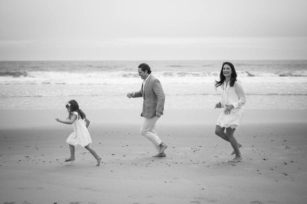 Black and white photography traditional family beach photos.