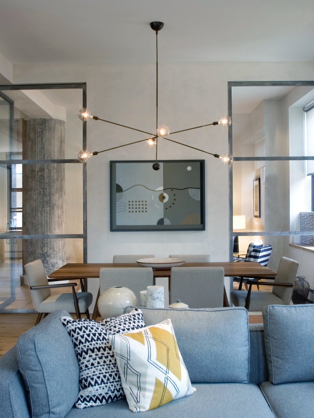 SoHo loft contemporary living room and dining room interior design by Jones Rowan Studio.