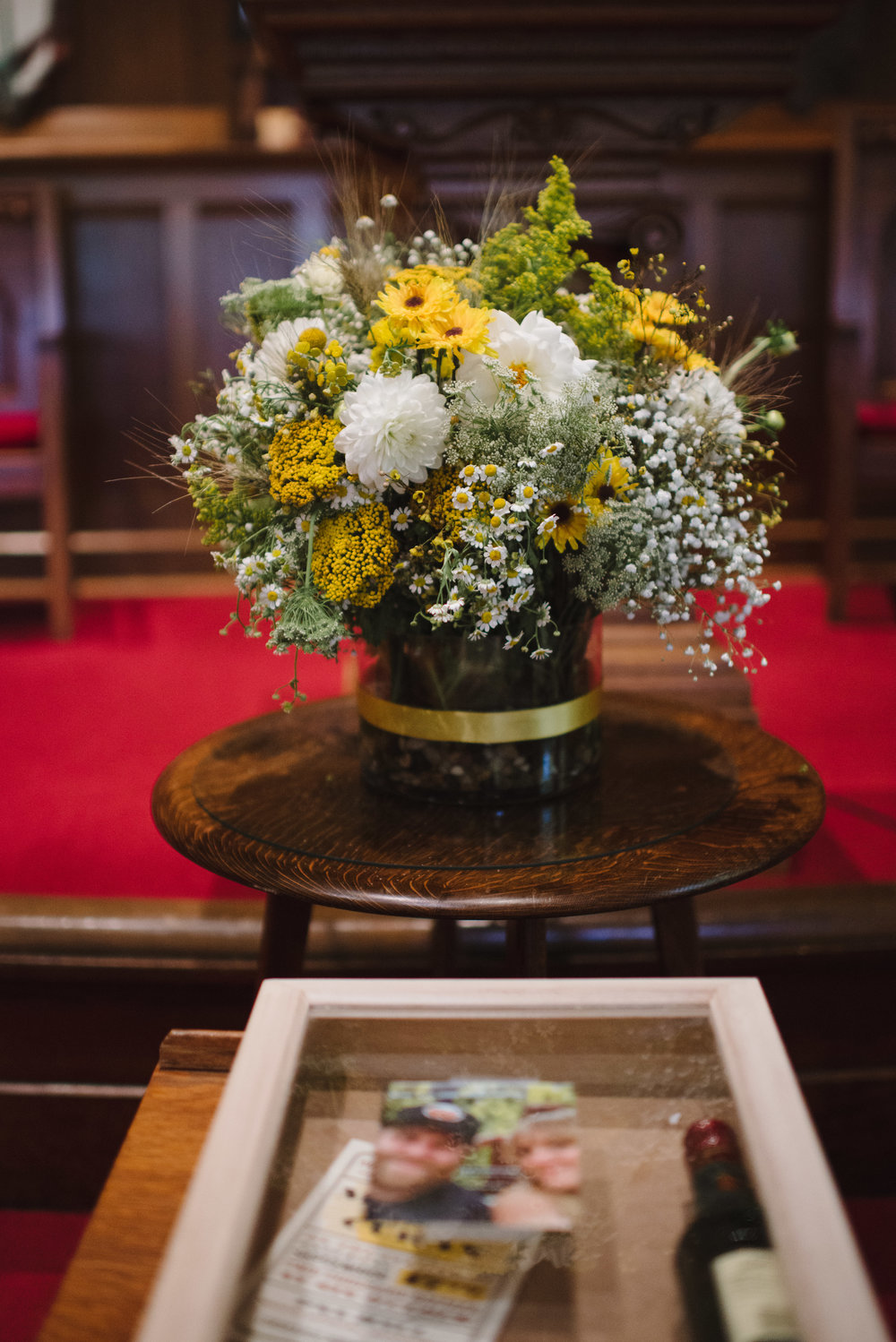 // focal point arrangements //   An overflowing arrangement placed in a central focal point at your ceremony can transfer to your reception after you're hitched!