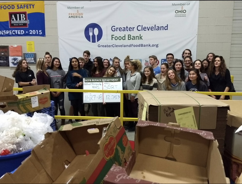 Strongsville High School National Honor Society students gather at the Greater Cleveland Food Bank to distribute meals in the region.
