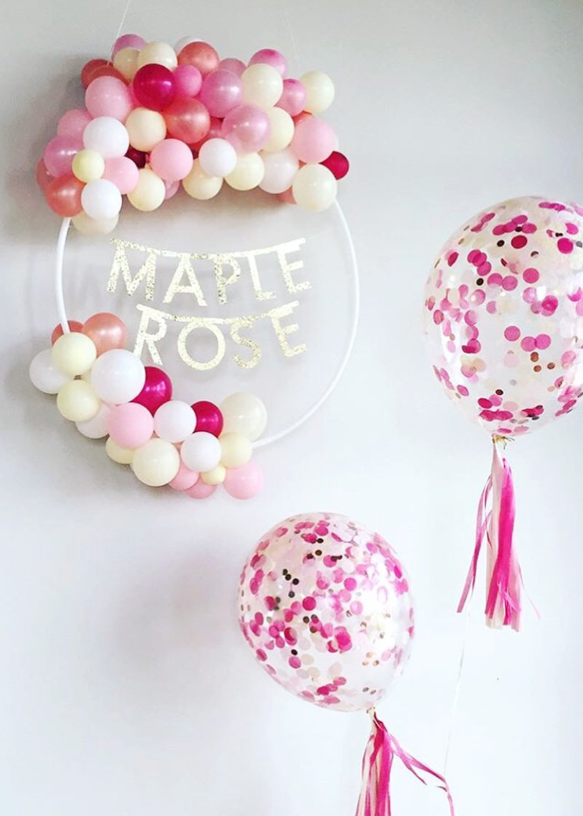 Organic Balloon Wreath with gold letters and 2 medium confetti balloons.