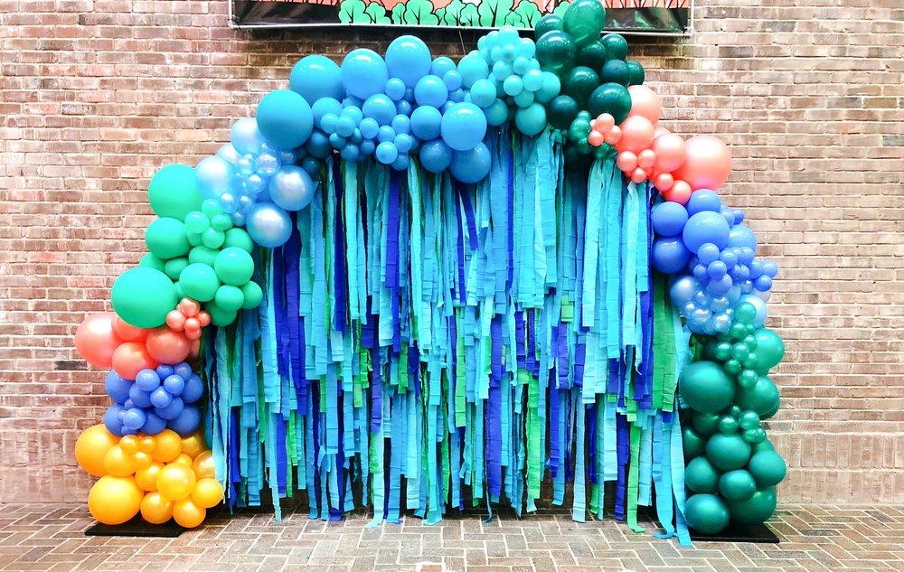 vroom_vroom_balloon_tassel_backdrop_freestanding_vroom_vroom_balloon_organic_balloon_installation.JPG