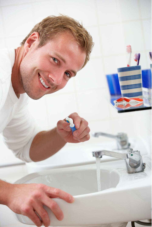 Man Brushing Teeth Sink Smile.png