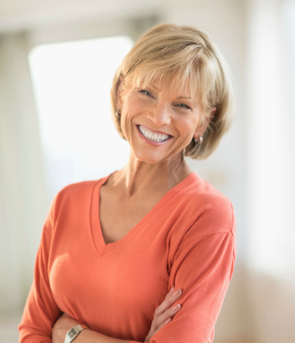 Mature Woman Smile Standing with Arms Crossed.png