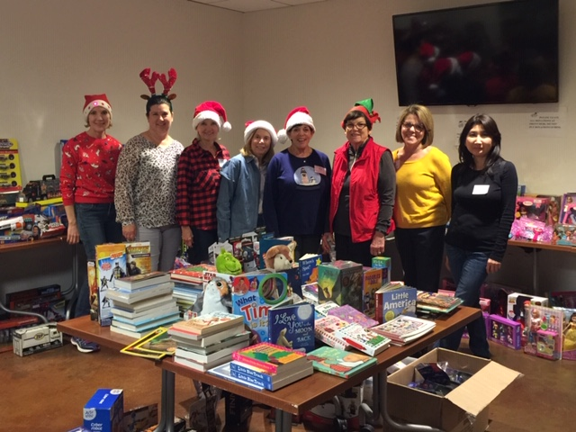 Many thanks to our volunteers who helped put smiles on the faces of kids and parents at the HIS Toy Drive!
