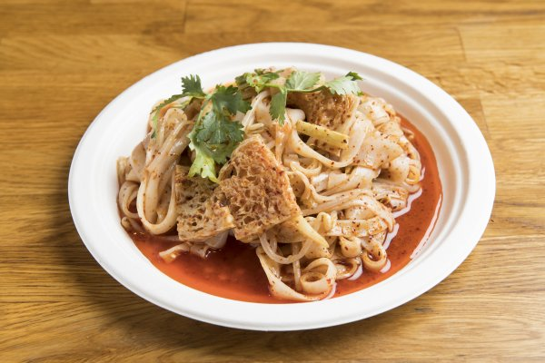"[A1] Liang Pi ""Cold-Skin Noodles""   Chewy wheat flour noodles, tossed with bean sprouts, cucumbers, cilantro, and cubes of spongy gluten, in all our proprietary sauces, which includes soy sauce, black vinegar, garlic, and chili oil (unless requested not spicy)."