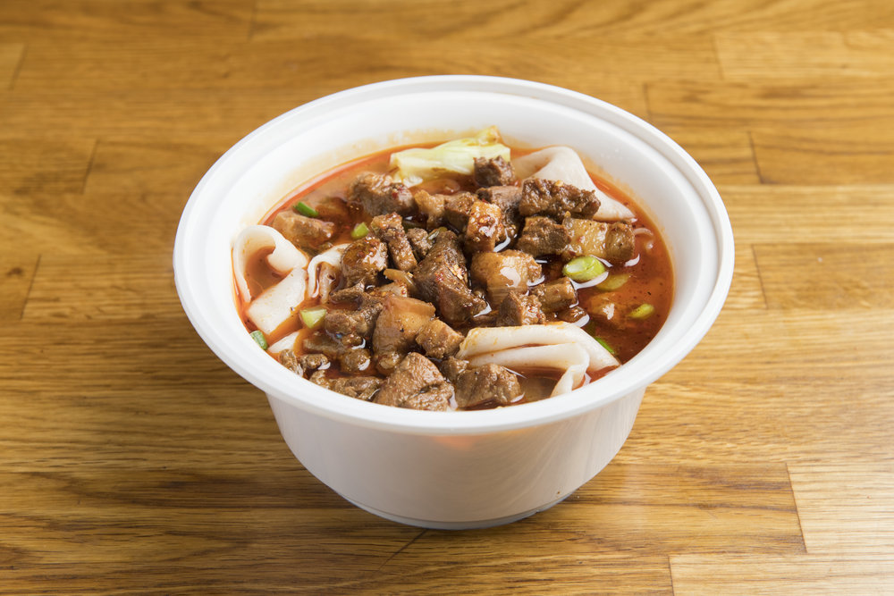 [NS3] Mt. Qi Pork Hand-Ripped Noodles in Soup   Diced pork belly served in a spicy, sour, and tingly noodle broth, a signature of the Mount Qi region near Xi'an, mixed with hand-ripped noodles.