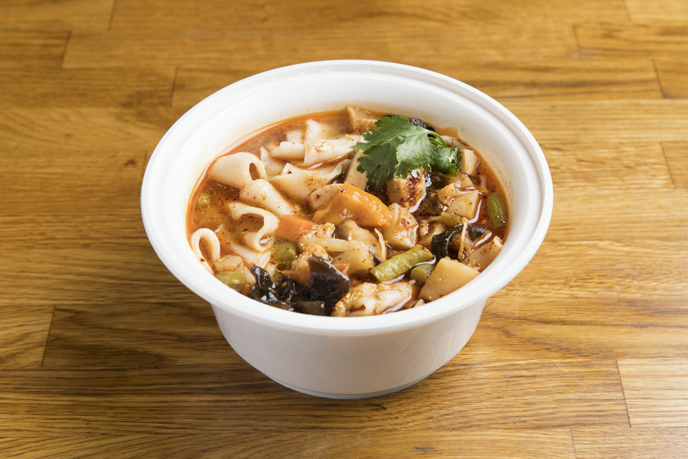 "[NS5] Mt. Qi Vegetables Hand-Ripped Noodles in Soup   Our wide hand-ripped biangbiang noodles mixed with a ""ratatouille"" of ingredients including but not limited to carrots, potatoes, wood ear mushrooms, bell peppers, and seitan, with a spicy (unless requested as not spicy) and sour noodle broth."