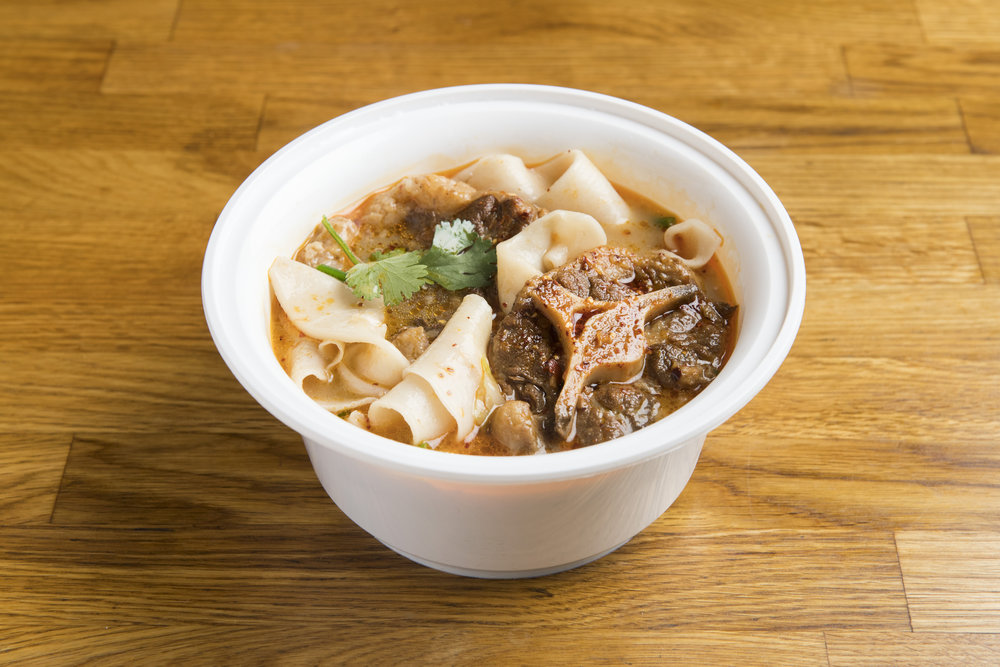 [NS10] Stewed Oxtail Hand-Ripped Noodles in Soup   Our biangbiang wide, hand-ripped noodles, topped with sliced stewed oxtails which were stewed in soy sauce and spices, in a beef broth.