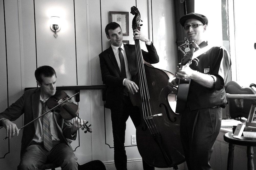 The Milkman and Sons -Marcus Milius (harmonica, voice & guitar) -Karl Meyer (violin) -Luc Decker (upright bass).JPG