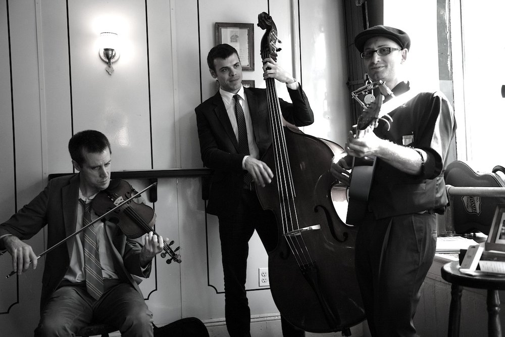 The Milkman and Sons -Marcus Milius (harmonica, voice & guitar) -Karl Meyer (violin) -Luc Decker (upright bass).JPG