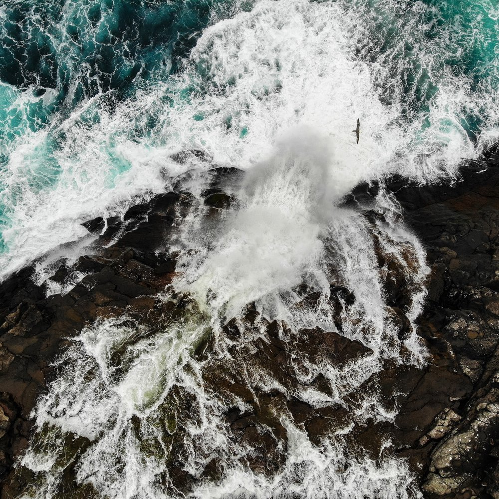 Aerial view of the waterfall into the ocean