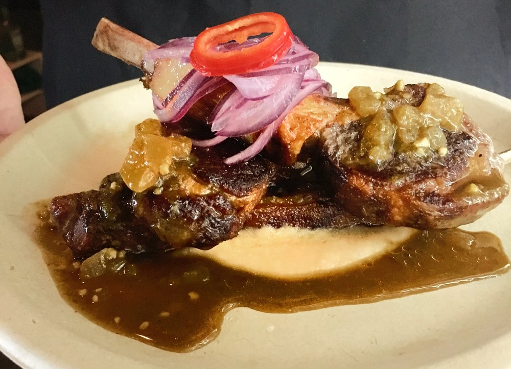 Lamb Chop Seco - seared lamb chops, pale ale and cilantro sauce, canary bean puree, salsa criolla, jasmine rice$12