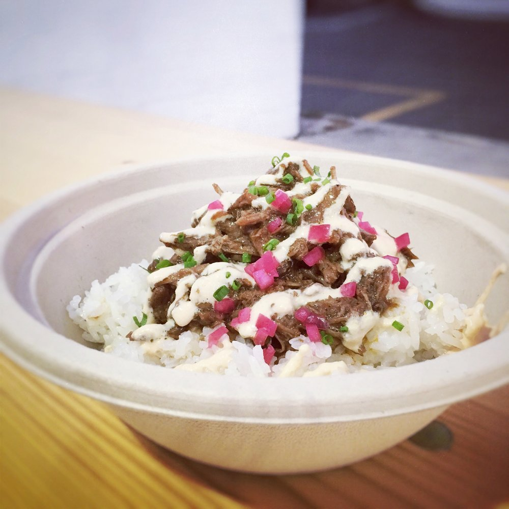 Braised Carne - slow cooked beef, ají crema, house relish, greens, jasmine rice$10