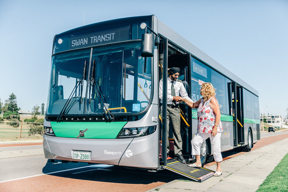 Elderly lady is helped onto a bus in Perth by Swan Transit driver