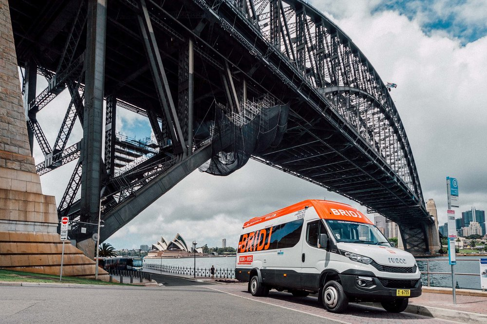A BRIDJ bus under the Sydney Harbour Bridge