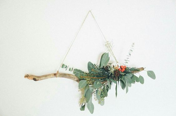 Holiday wreath with eucalyptus, pinecone, berries and driftwood