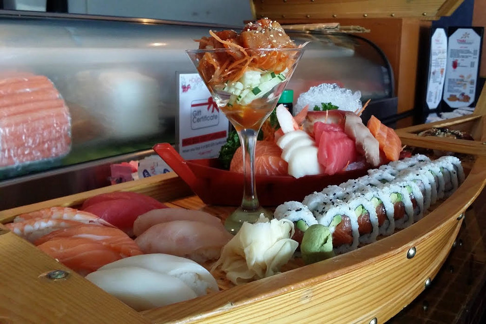 Boat For 2 - 12 pcs of Sushi, 18 pcs of Sashimi, 2 Chef's Testers, J.B Roll & California Roll.