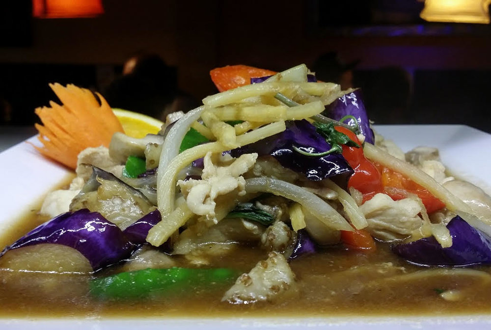 Exotic Eggplant - Sautéed Onion, Red pepper, Corn, Mushroom, Snow Peas and Bamboo  in Sweet Basil Sauce.