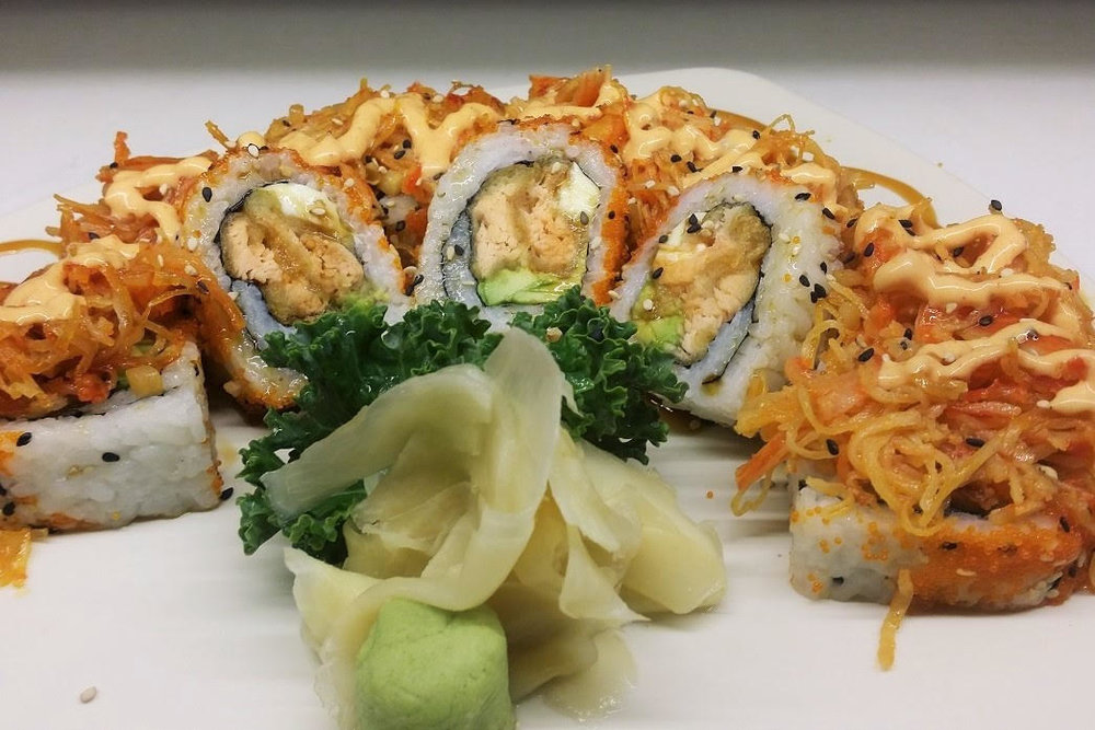 Orlando Roll  - Salmon Tempura, Cream Cheese, Avocado and Masago topped with Volcano sauce, Spicy Mayo and Eel Sauce. I/O