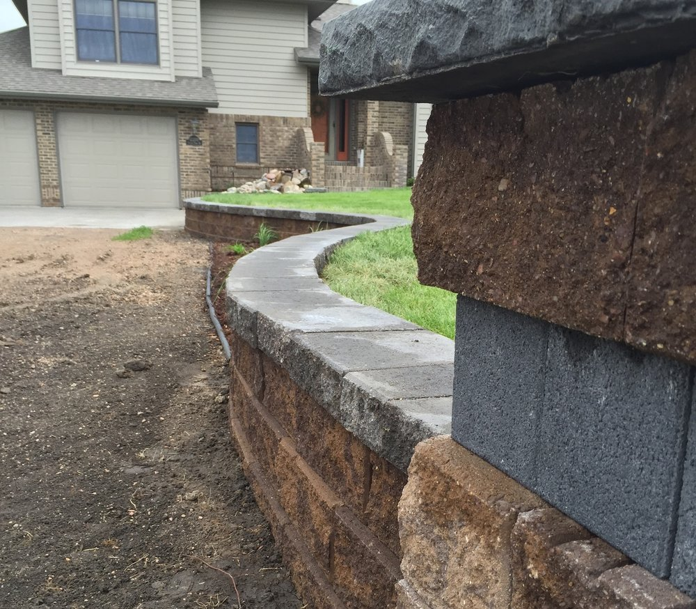 Retaining Walls - The term wall just seems so boring... but we ensure you that our retaining walls are not only eye catching, but they're also as solid as they come. We guarantee our walls will stand firm and strong through the toughest Nebraska seasons.