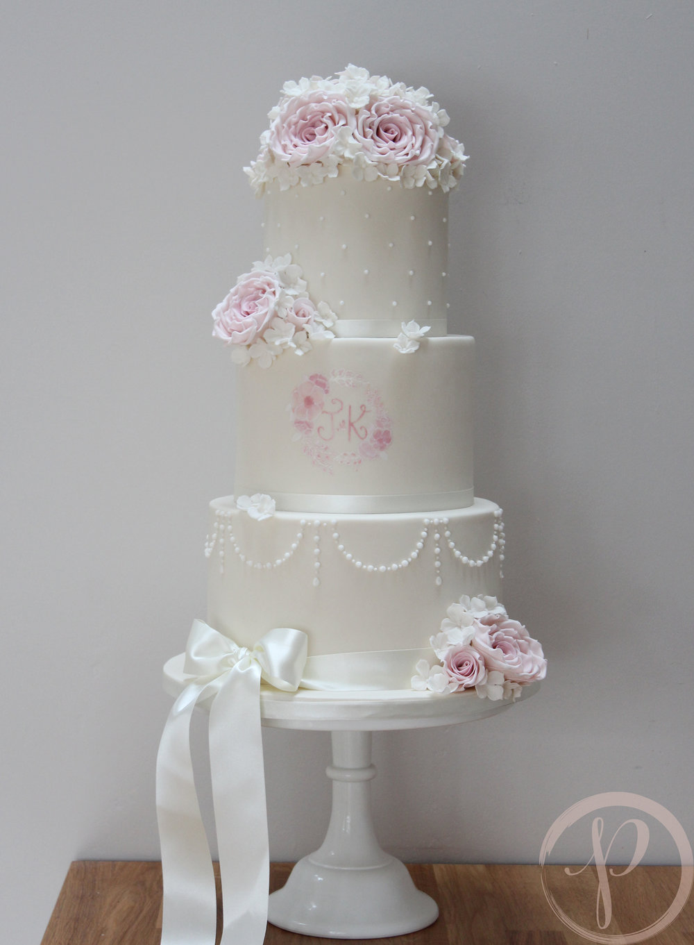 pearl wedding cake with blush sugar flowers.jpg