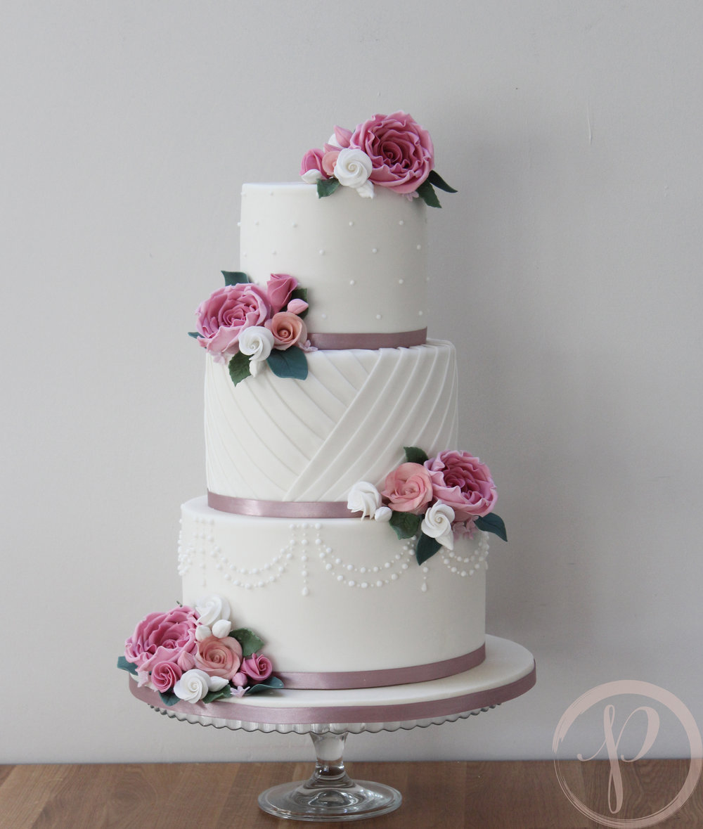 dusky pink wedding cake with pleats and pearls.jpg