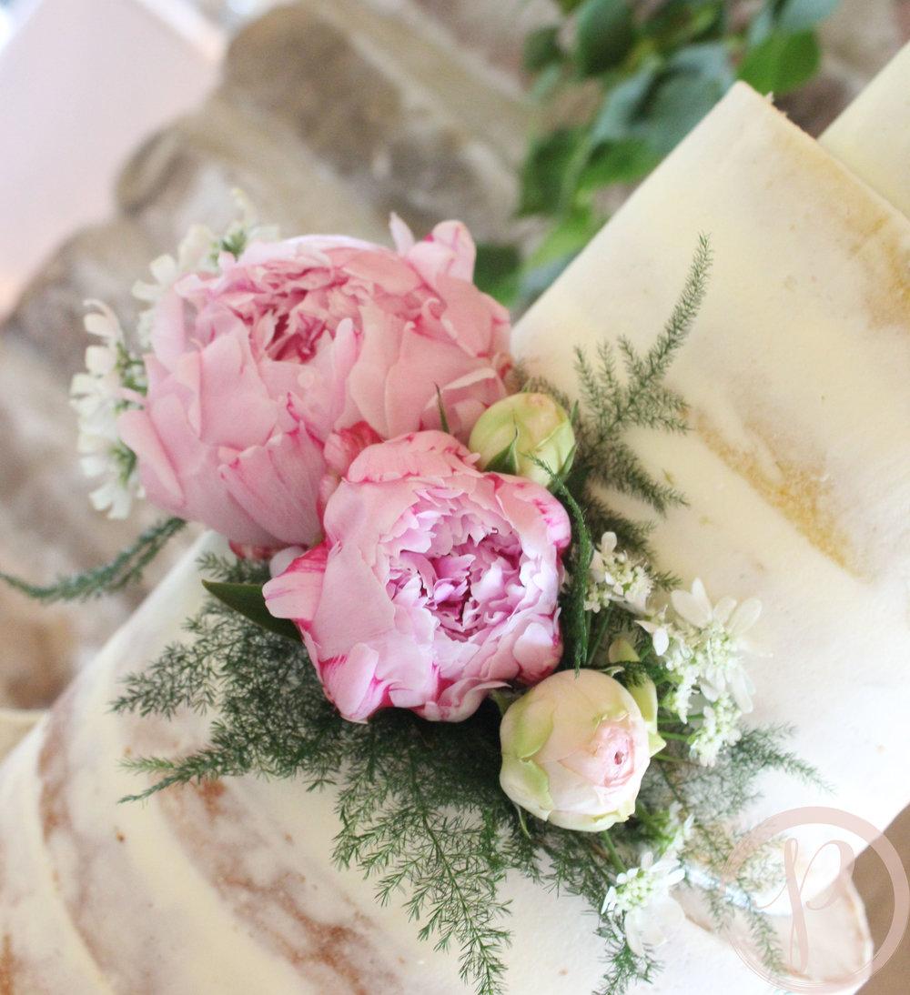 pink peonies semi naked wedding cake.jpg