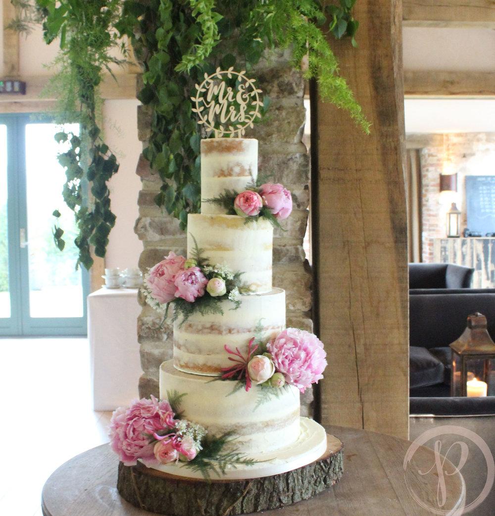 pink peony semi naked wedding cake.jpg