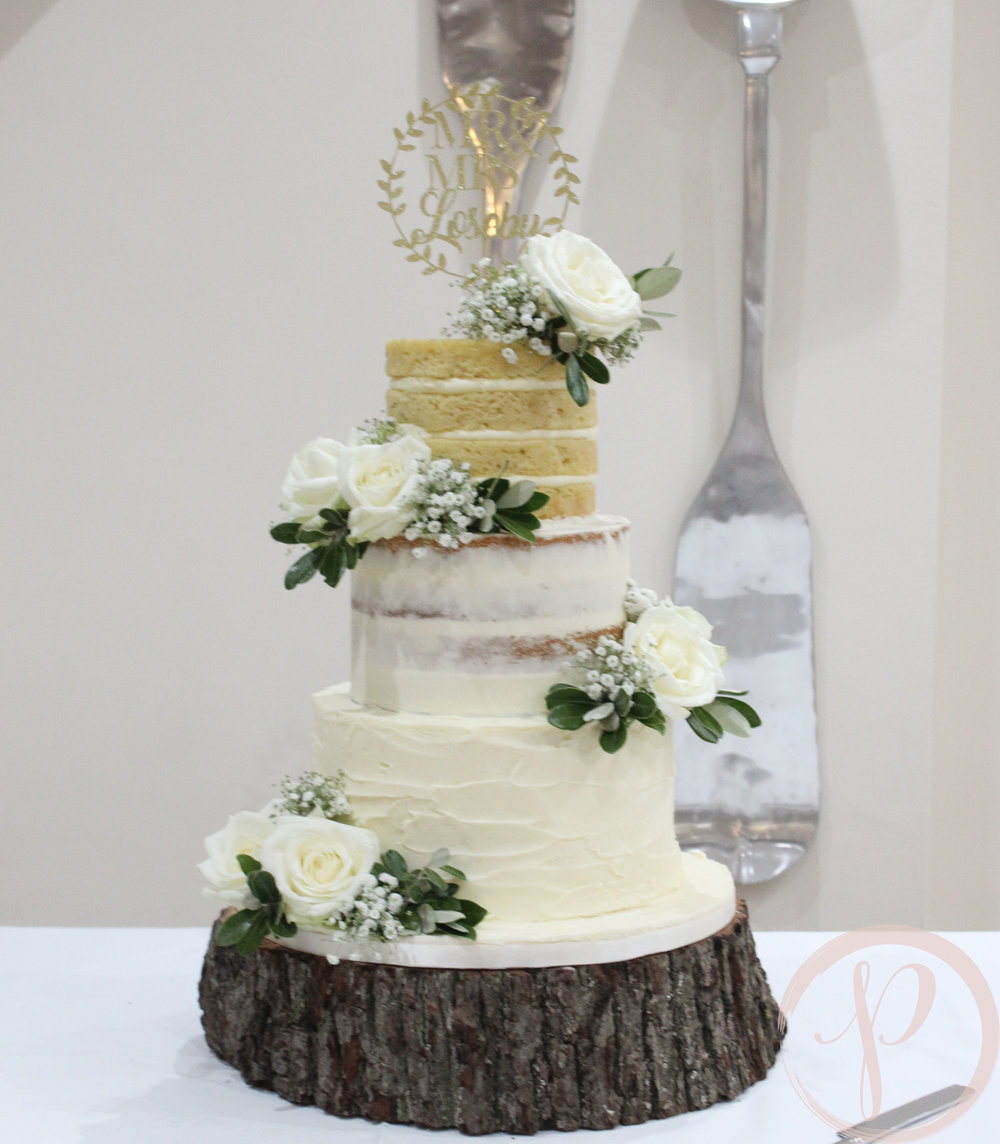gradiented naked wedding cake with beautiful white flowers.jpg