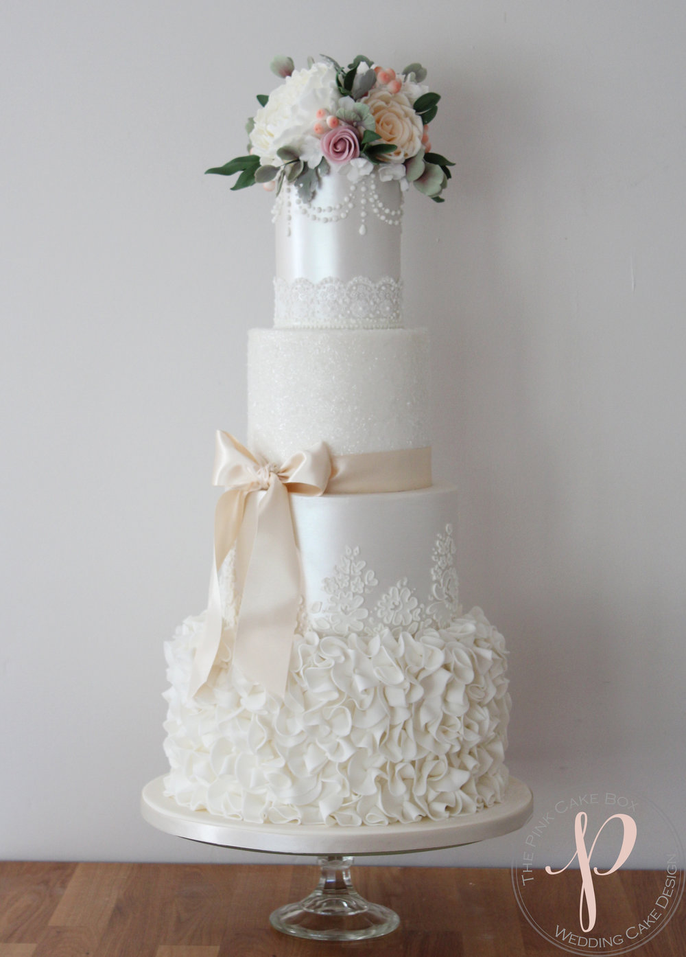 ruffle pearl lustre lace wedding cake with sugar flowers.jpg