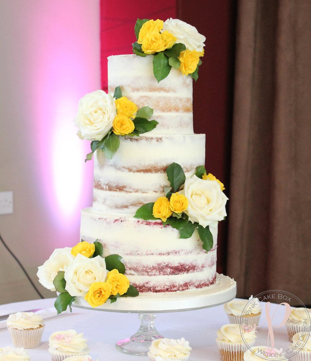 yellow ivory semi naked wedding cake.jpg