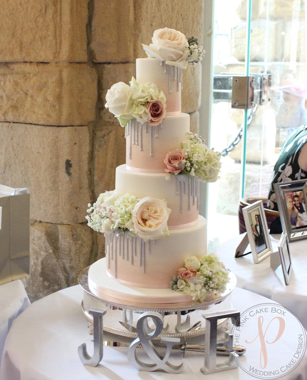 blush ombre wedding cake with metallic drips.jpg