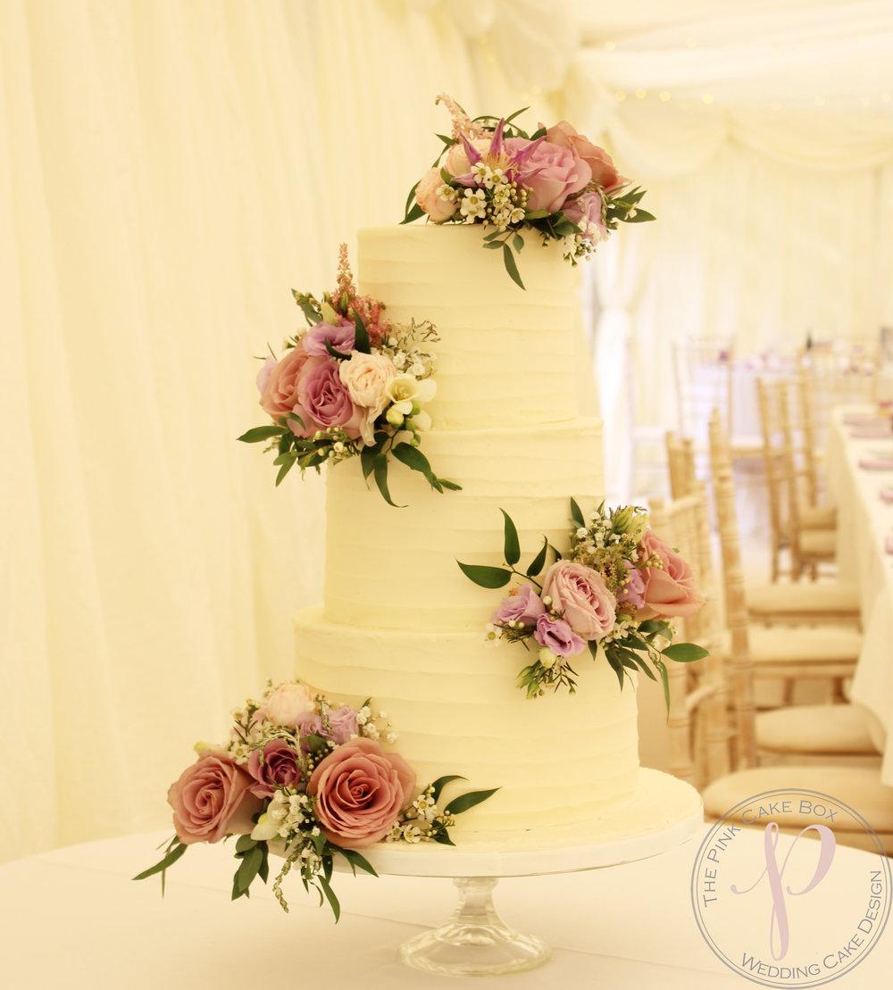 buttercream wedding cake with fresh flowers lilac pink.jpg