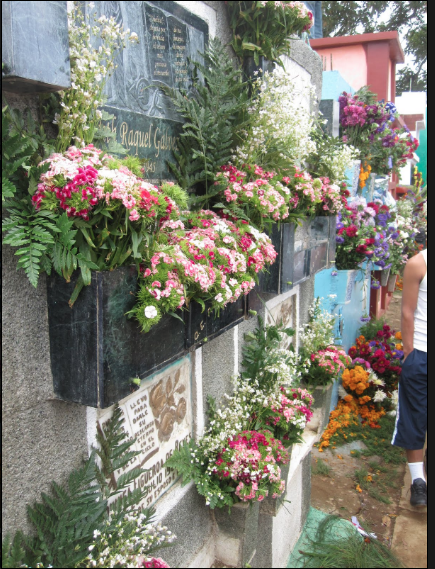 It is a tradition to elaborately decorate graves of ancestors in Guatemala for All Saints Day.
