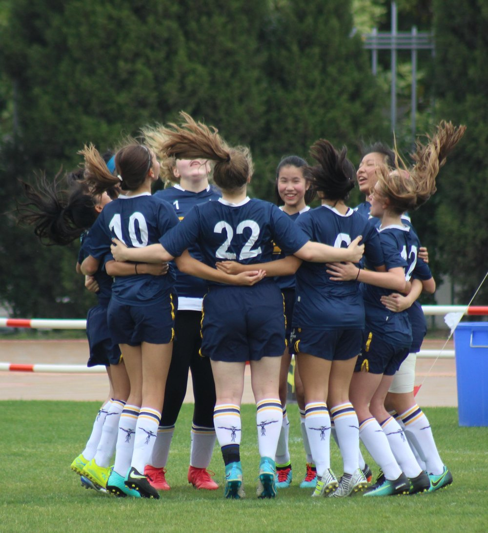 "The Junior Varsity soccer team shows unity prior to the J-PAC championships at SAS Puxi. If this photo could speak, you would hear 10 girls in unison shouting, ""Concordia! Phoenix! Concordia! Phoenix!""  (Photo: W. Turner)"