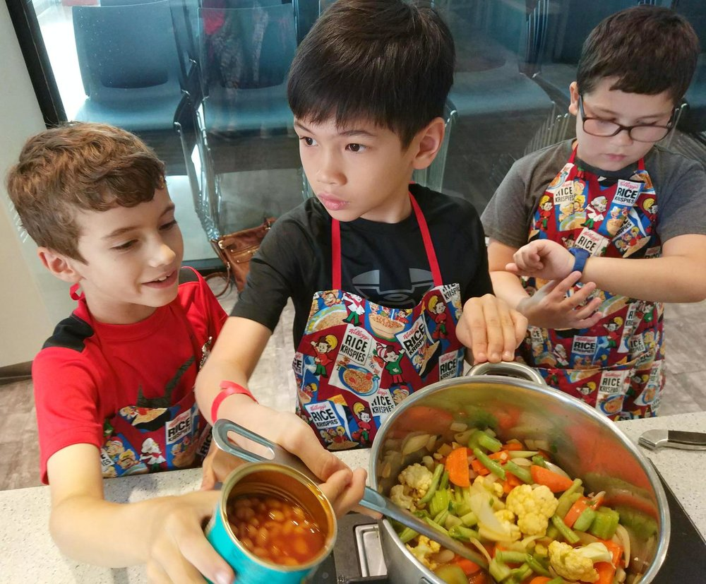 Kohen, Ryder and Auggie put forth their best culinary skills in the MasterChef event at the Jinqiao Mini-maker Faire.  (Photo: Brian Lavender)