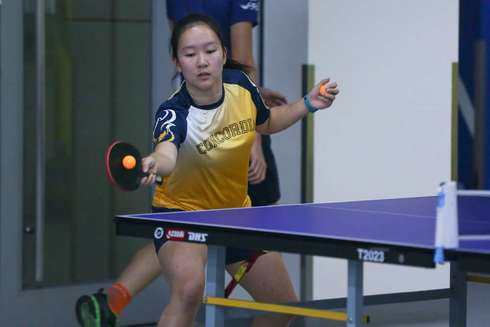 """""""People tend to consider table tennis as an individual sport, but it is set up to foster teamwork and cooperation."""" - Varsity Table Tennis player Chloe L.  (image: K. Hawkins)"""