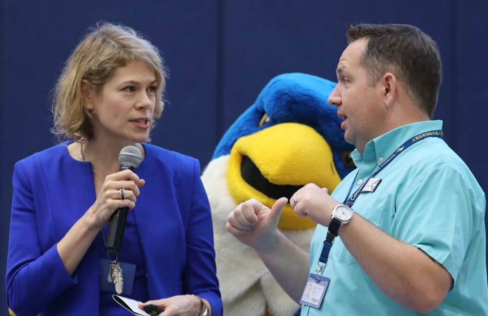 A curious bird: Blaze is seen during a playful moment with Assistant Head of School Ms. Petersen with Early Childhood Principal Mr. Gerdes.  (image: Brian Lavender)