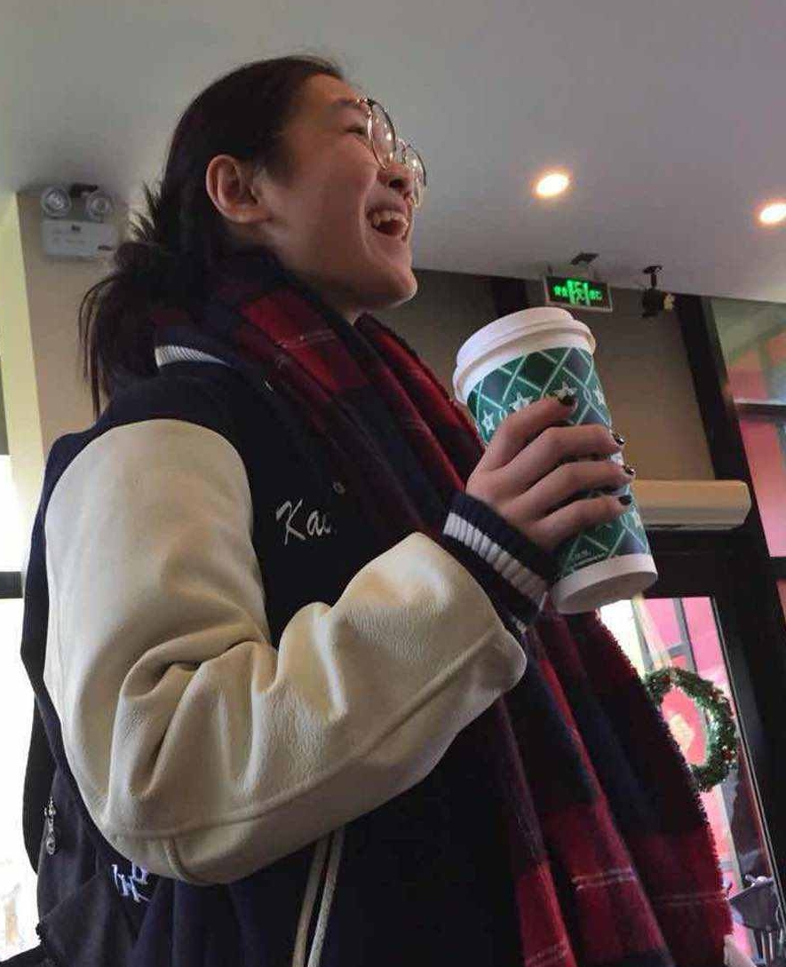 Laughter, warm cup and a cozy letterman announce the arrival of the cooler temperatures.  (image: Abigail W., Concordia Applied Journalism)