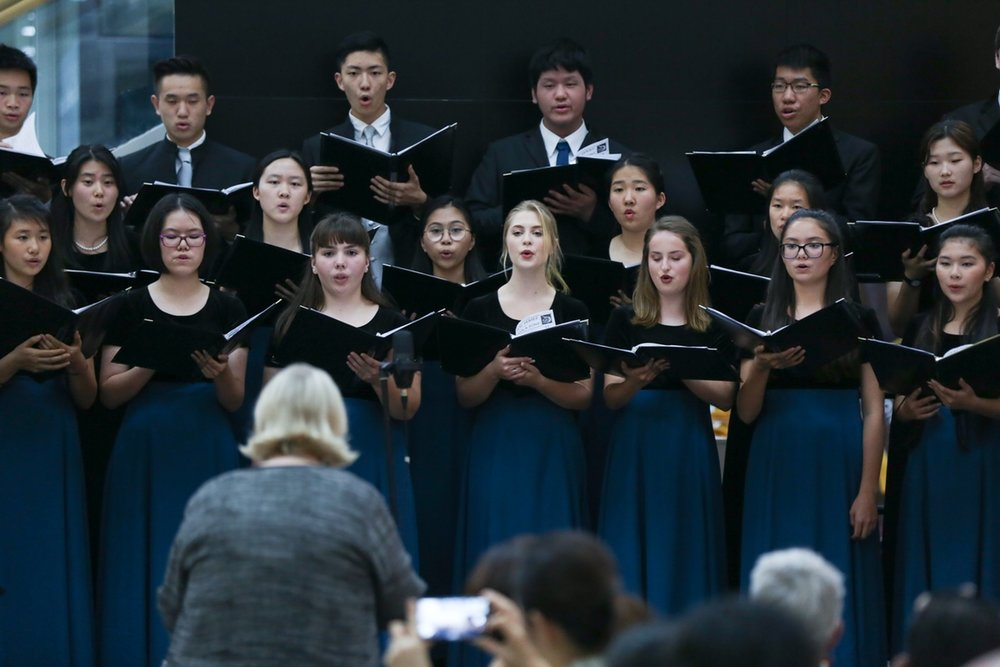 Choir members are busy preparing for a tux-and-gown performance at the Christmas concert.  (image: Kirk Hawkins)