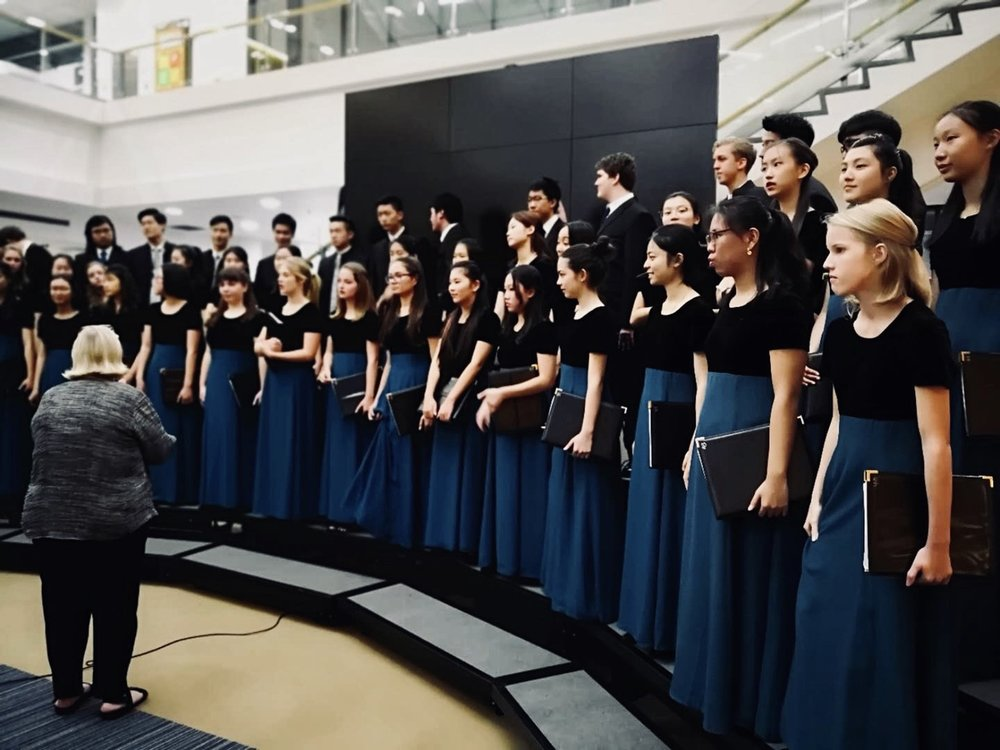 Ms. Ideker has been working with her students to refine the slate of songs for the Christmas Concert.  (image: Huifen Ma)