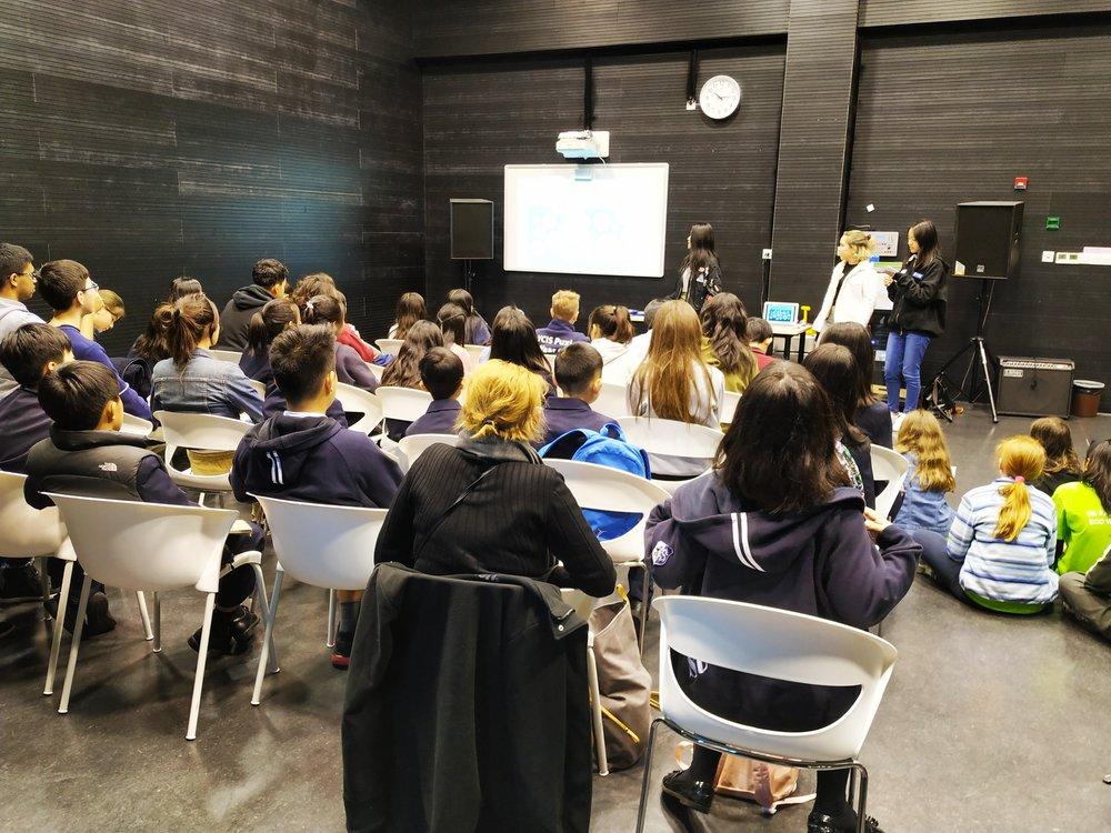 Concordia GIN students Eleri, Lillian and Daisy lead a workshop about plastics for dozens of Eco Summit participants.