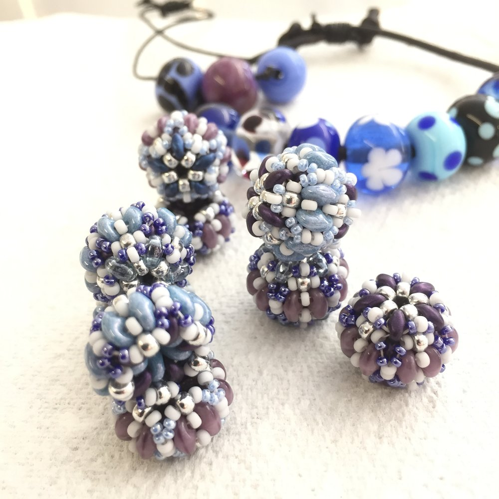 In the foreground are Rosie' beaded beads. Behind them are beads that she'd made on a previous course with me. It's lovely when different beads come together in harmony! September 2018