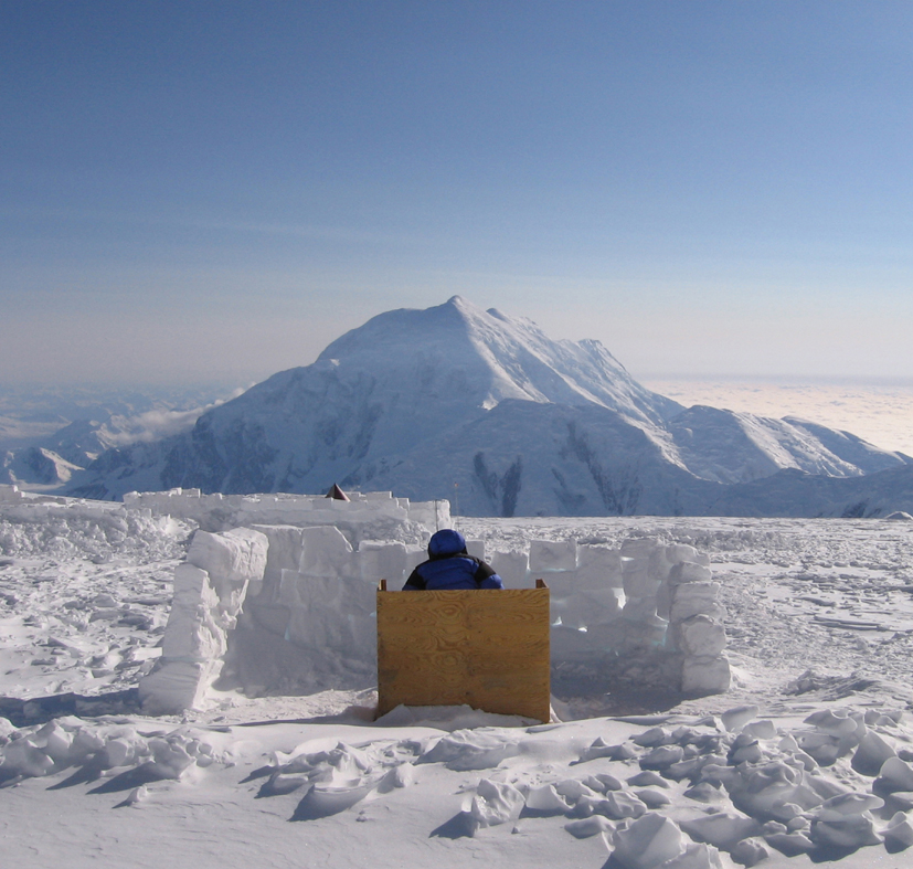 The toilet at Camp 3 on Denali, Alaska, comes with a magnificent view of nearby Mount Foraker. Photograph Pat Baumann.