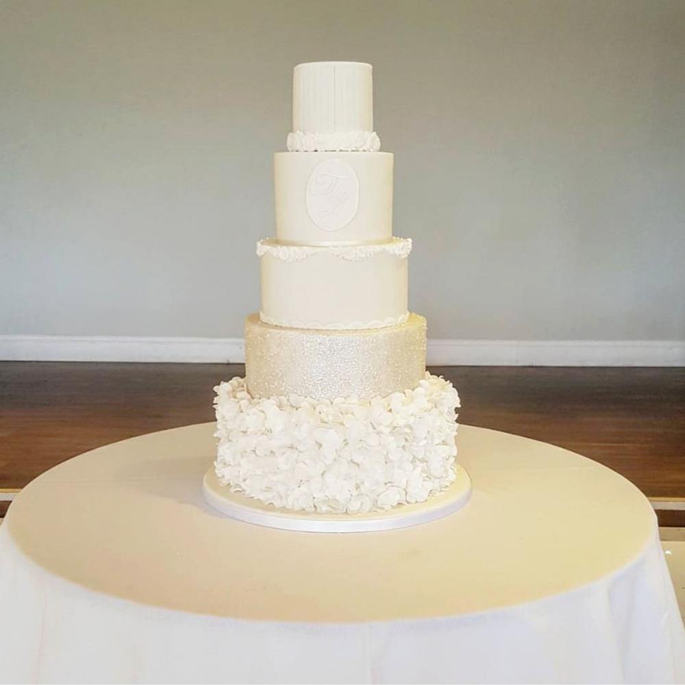 DOTTY ROSE WEDDING CAKE DESIGN 5 TIER PINK RUFFLED.png