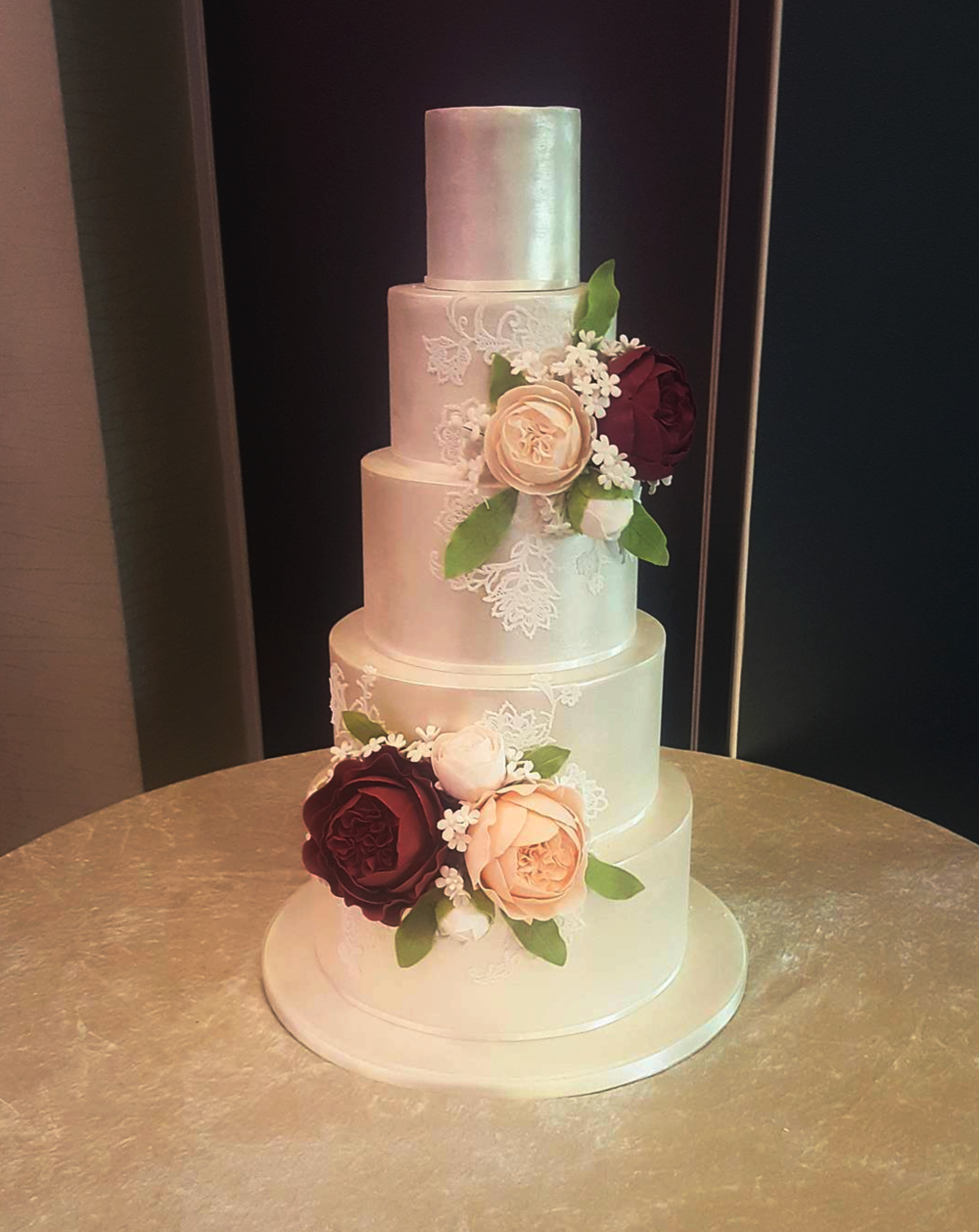 DOTTY ROSE CAKE DESIGN 5 TIER SILVER LUSTRE LACE WEDDING CAKE.png