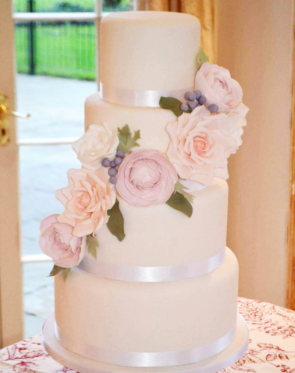 DOTTY ROSE CAKE DESIGN 4 TIER FONDANT WEDDING CAKE.png
